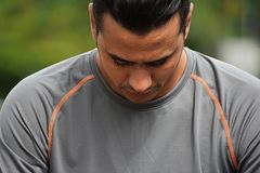 Sad Athlete Colombian Person. A handsome adult hispanic man Royalty Free Stock Image