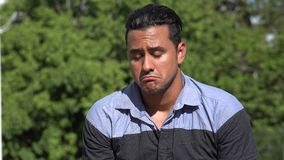 Sad Confused Adult Hispanic Man. A handsome adult hispanic man stock video footage