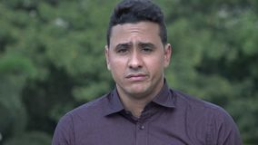 Sad Handsome Hispanic Man. A handsome adult hispanic man stock footage