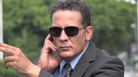Secret service agent or male bodyguard. A handsome adult hispanic man