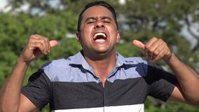 Singing Adult Hispanic Man. A handsome adult hispanic man stock footage
