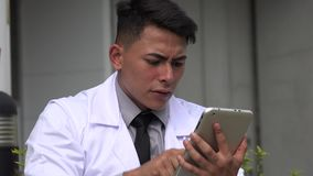 Stressed hispanic male doctor. A handsome adult hispanic man stock video