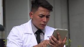Stressed hispanic male doctor stock video