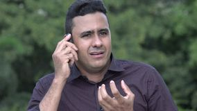 Stressed Hispanic Man Using Cell Phone. A handsome adult hispanic man stock video