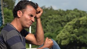 Stressed Young Hispanic Man. A handsome adult hispanic man stock video