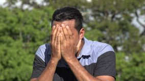 Timid Fearful Adult Hispanic Man. A handsome adult hispanic man stock video