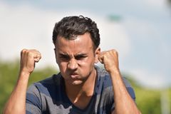 Young Male And Anger. A handsome adult hispanic man Stock Images