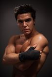 Handsome adult man. Portrait of handsome adult man with big muscles on dark background Stock Images