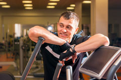 Handsome adult man in the gym resting Royalty Free Stock Images