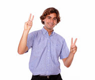 Handsome adult man showing you victory sign. Portrait of a handsome adult man showing you victory sign on isolated background Royalty Free Stock Photos