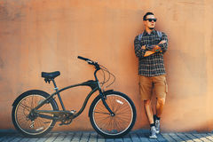 Handsome Adult Man Standing With Bicycle Near Wall Daily Routine Lifestyle Concept Royalty Free Stock Images