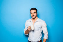 Handsome adult man wearing casual clothes on  blue background Stock Image