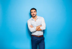 Handsome adult and masculine man on a blue background Stock Photo