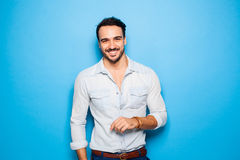 Handsome adult and masculine man on a blue background Royalty Free Stock Image