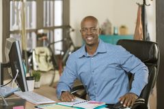Handsome African American Business Man. Handsome professional man working in a creative office Stock Photography