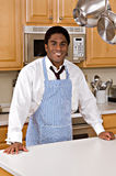 Handsome African-American businessman in kitchen stock photography