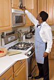 Handsome African-American businessman in kitchen stock photo