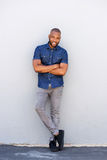 Handsome african american guy smiling with arms crossed Royalty Free Stock Photography