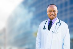 African American Male Doctor Outside of Hospital Building Royalty Free Stock Photos