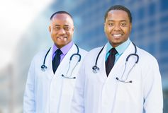 Two African American Male Doctors Outside of Hospital Building Royalty Free Stock Photos