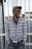 Handsome African American male model laughing outdoor portrait Stock Photography