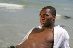 Handsome African American Man on the Beach With Ba Stock Images