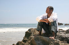 Handsome African American Man on the Beach Thinkin Royalty Free Stock Images