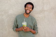 Handsome african american man with green smoothie Stock Image