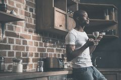 Handsome african american man having his morning coffee royalty free stock photo