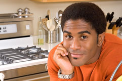 Handsome African-American man in kitchen Royalty Free Stock Image