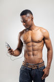 Handsome African American man listening music Stock Image