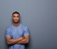 Handsome african american man posing with arms crossed Stock Images