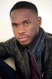 Handsome african american man posing in black leather jacket Stock Photography