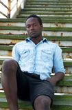 Handsome african american man sitting on stairs outdoors Stock Photography
