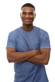 Handsome african american man smiling with arms crossed Royalty Free Stock Images