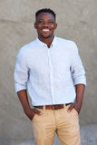 Handsome african american man smiling by wall Royalty Free Stock Images