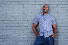 Handsome african american man standing against a gray wall Stock Images