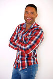Handsome african american young man with checkered shirt smiling Stock Photography