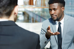 Handsome African Businessman Discussing Work with Partners royalty free stock photography