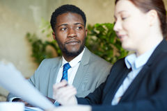 Handsome African Businessman in Meeting with Colleague royalty free stock photos