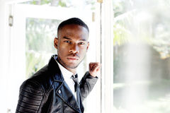 Handsome african male fashion model. Close up portrait of handsome african male fashion model standing by a window Royalty Free Stock Photo