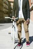 Handsome african man on bike in the city. Stock Images