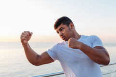 Handsome african man boxer doing exercises in the morning Stock Images