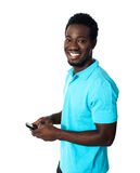 Handsome african man using cellphone Stock Images