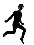 Handsome african young man jumping screaming silhouette Stock Photos