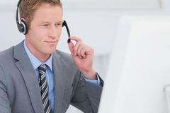 Handsome agent wearing headset Stock Photos