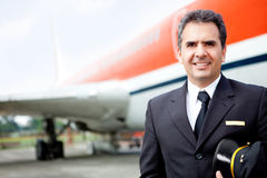 Handsome airplane pilot Stock Photography