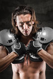 Handsome american footballer royalty free stock photography
