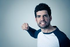 Handsome angry young man with furious face looking disgusted. Human expressions and emotions. Portrait of young hipster male looking furious with angry royalty free stock photography