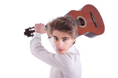 Handsome, angry young man musician guitar player. Handsome and angry young man musician guitar player portrait on white, studio shot Royalty Free Stock Photography